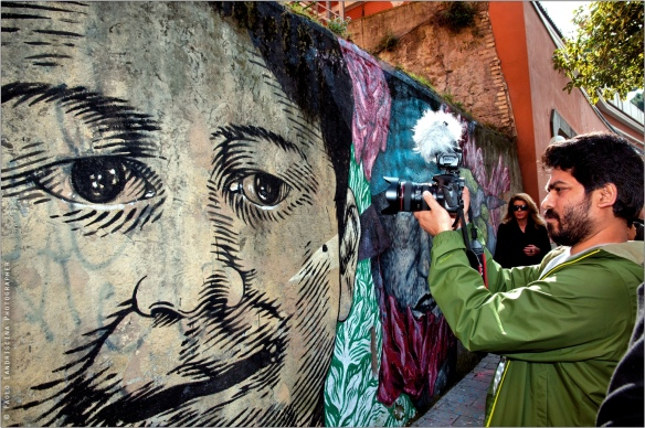 Paul James Gomes filming street art about immigrant families in Tor Pignattara, also known as the Bangla Town of Rome.