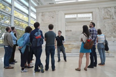 Mark Bradley, lecturing a group of award-holders, in front of the Ara Pacis