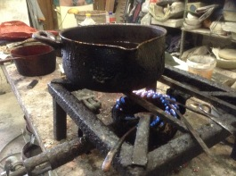 Wax is heated to pour into a refractory plaster imprinted mould. Photo by: Mark Andrew Kelly
