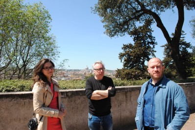 Staff member Katherine Paines with David and Ross, with the view behind them