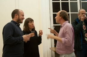 Two artists and a guest enjoy a glass of prosecco at the opening party