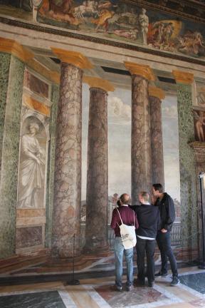 Three award-holders inspect the graffiti in the upstairs of the Villa Farnesina