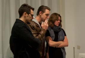 Three award-holders admire the art