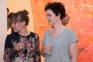 Rachel and a guest admiring the art
