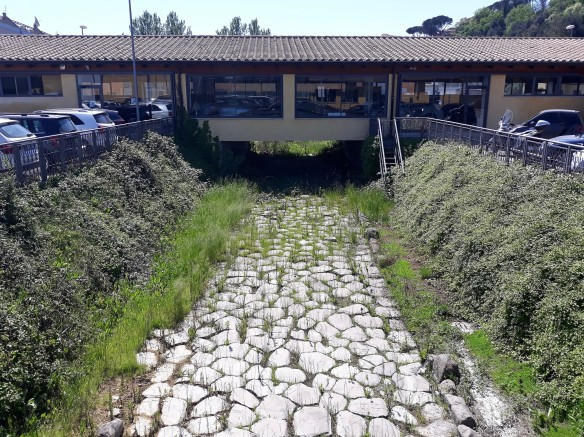 The Via Flaminia Antica running through the middle of a car sales yard on the way to Prima Porta.jpg